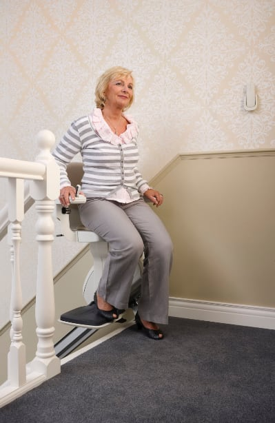 lady getting off of homeglide stairlift