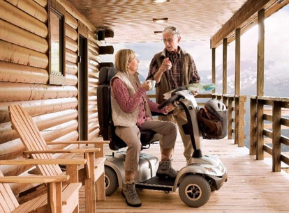 couple in mountain cabin with mobility scooter