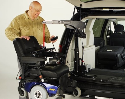 man lifting power wheelchair with bruno big lifter