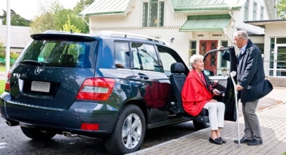 woman leaving vehicle using a turning seat
