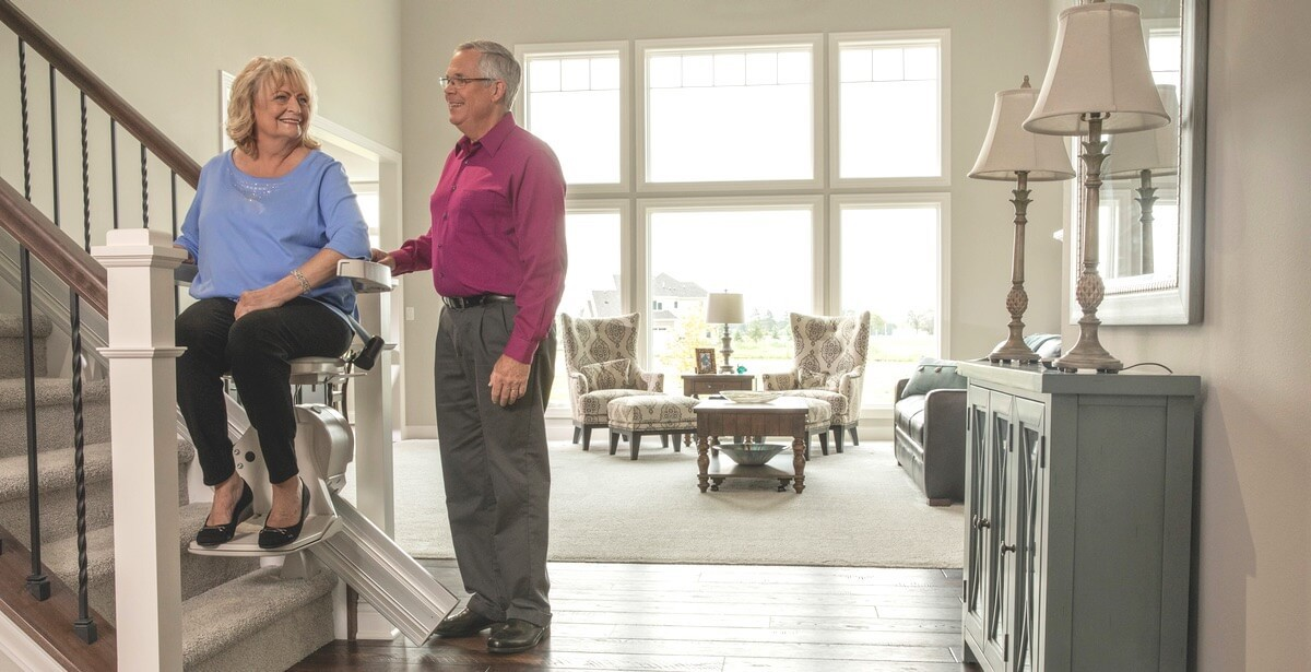 couple using bruno stair lift