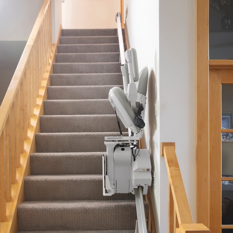 stairlift-on-rail-in-stairway