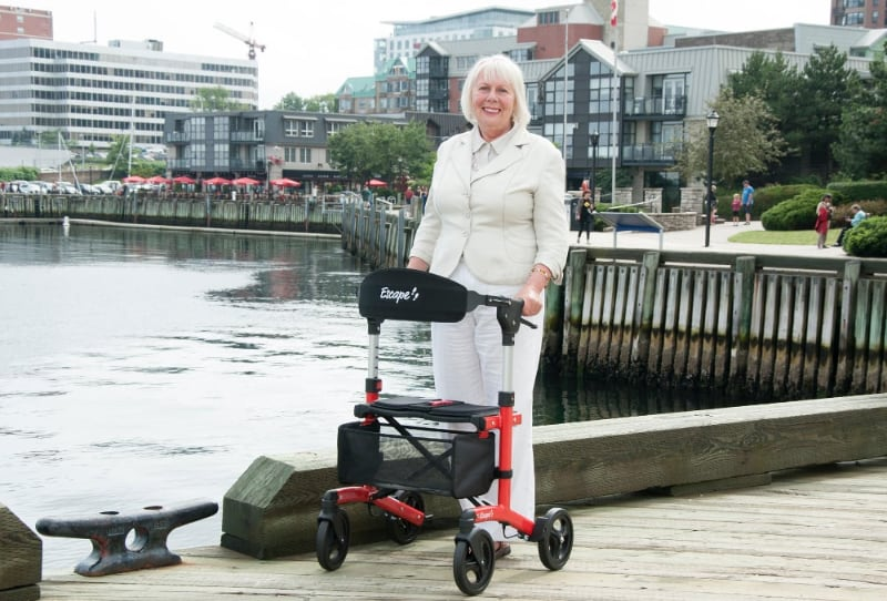 walker for mobility with woman and dog