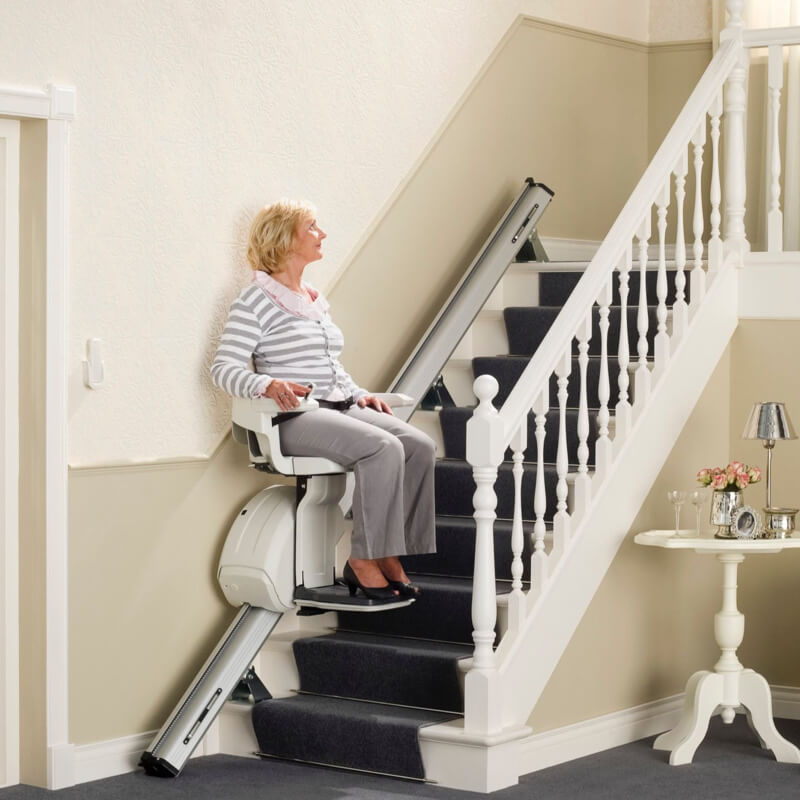 lady going up on stairlift
