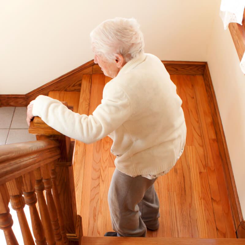 senior woman down stairs