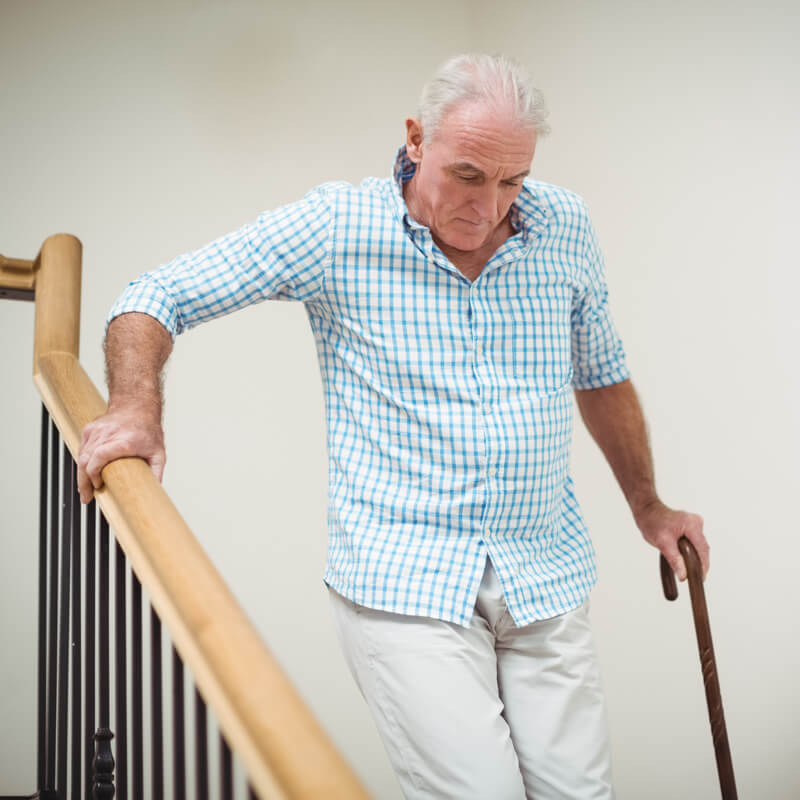 man having trouble decending stairs